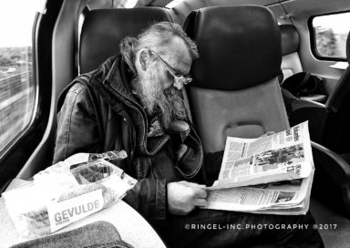 Old man and his newspaper.